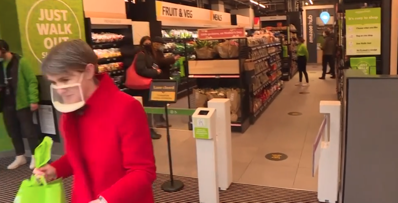Woman leaving a shop after an Amazon experience